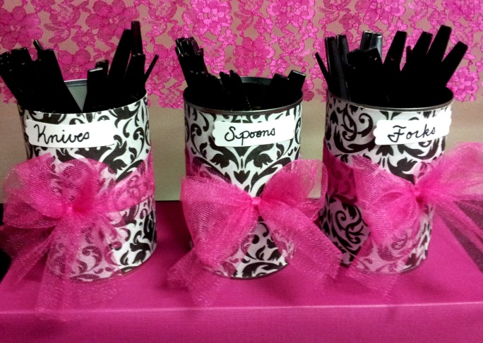 Simple cans covered in paper with a tulle bow,