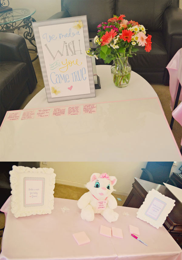 sign in for Pretty pink and purple baby shower decor